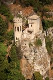 Fairy tale castle. Middle age castle between rocks and trees, with tower Royalty Free Stock Image