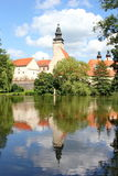 Fairy tale castle and its mirror image on the surface of the pond, Telc, Moravia, Czech republic Royalty Free Stock Photography