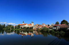A fairy tale castle and old town city with lakeside mirror reflection in Telc, Czech Republic Stock Photos