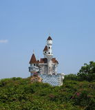 Fairy tale castle rising above the trees at DreamWorld. A fairy tale castle rising above the trees at famous amusement park Dream World, on April 17, 2015 in Royalty Free Stock Photos