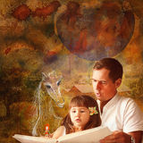 The fairy tale for the child. The father reads the fairy tale to the little daughter Royalty Free Stock Photography