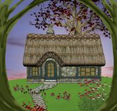 Fairy tale cottage. Beautiful cottage in the middle of the country with a tree frame Royalty Free Stock Image