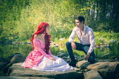 Fairy Tale Couple Sitting on Large River Rocks Stock Photography