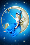 Fairy-tale girl on the moon. Girl in dark blue clothes with stars Stock Images