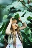 Fairy tale girl. Portrait a little girl in a deer dress with a painted face in the forest. Big antler. Fantasy girl. Springtime. royalty free stock photo