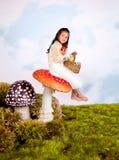 Fairy tale girl on toadstool stock photos