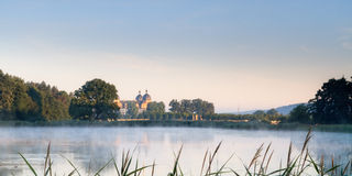 Fairy Tale Lake at Chateau Seehof. Chateau Seehof in the Morning behind a foggy lake Stock Images