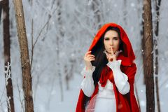 Snow White Princess in Red Cape Keeping a Secret in Winter Stock Photos