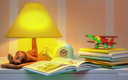 Fairy tale for the night. Books, toy plane, lamp, alarm clock Royalty Free Stock Images