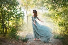 Free Fairy-tale Princess In Light Summer Blue Turquoise Dress On Wide Path Stock Photo - 155958740