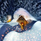 Fairy-tale snow-covered house in the mountains royalty free stock images