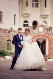 Fairy-tale wedding couple. bride and groom on the background of the hotel or castle. Royalty Free Stock Photo