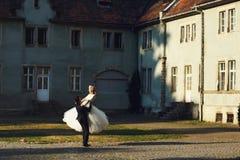 Fairy-tale wedding couple handsome groom swinging beautiful brid Stock Photography