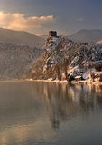 Fairy tale winter castle and its mirror image on the surface of river, Strecno, Slovakia royalty free stock photos