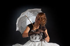 Fairy tale woman sitting with an umbrella Royalty Free Stock Photos