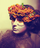 Fairy tale. Woman in wreath of rowan berry Royalty Free Stock Photography