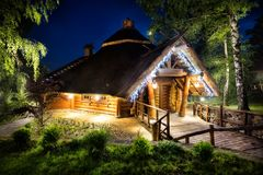 Fairy-tale wooden house illuminated lights Stock Photos