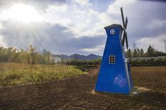 Fairy tale world blue windmill Royalty Free Stock Photo