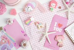 Fairy tales concept in pink and white. Cute macarons of mermaid. And unicorn. Top view. Love and Valentine`s theme. A pink postcard empty space is for your Stock Image