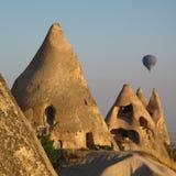 Fairy tower in Cappadocia. Cave houses and a hot air ballon Cappadocia, Turkey Stock Photo