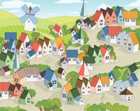 Fairy town. With multicolored toy houses, mill and fields with blue sky at background Royalty Free Stock Image