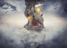 Fairy tree house on rock flying in fantasy sky. With clouds stock illustration