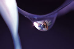 Fairy in a water droplet Stock Photography