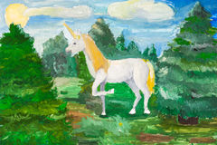 Fairy white unicorn in green fir forest Stock Photo