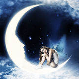 Fairy with wings sitting on moon Royalty Free Stock Photos