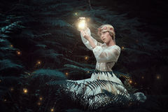 Fairy woman hunting fireflies Stock Photography