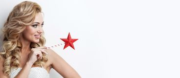 Fairy woman with wand. Portrait of beautiful fairy woman with star shaped magic wand stock photo