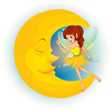A fairy with a yellow dress beside a sleeping moon Stock Images