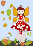 Fairytale. Little fairy in red dress on a fly agaric Stock Photography
