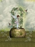 Fairytale. Scene with flowers stone and hummingbird Stock Photo