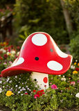 Fairytale. Place with lots of flowers and a big mushroom royalty free stock images