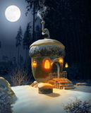 Fairytale Acorn House. 3D illustration of a fairytale acorn house in a idyllic winter landscape at night in the moonlight Stock Photos