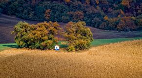 Fairytale autumn landscape with famous little chapel Santa Barbara in beautiful fields Stock Image