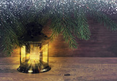 Fairytale background with lantern and Christmas tree on wooden b Stock Photos