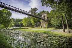 Fairytale bridge with green grass Stock Images