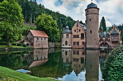 Fairytale Castle. Fairytale like Mespelbrunn Water Castle reflected in a pond and nestled in a forest. Subject of a fairy tale by the Brothers Grimm. Spessart Stock Image