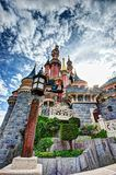 Fairytale Castle in France. Disney Castle on a bright sunny day with sun star in the background Royalty Free Stock Photo