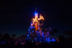 Fairytale Castle in France. Disney Castle painted with lights and fireworks Stock Photos