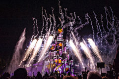 Fairytale Castle in France. Disney Castle painted with lights, fireworks and smoke Stock Images