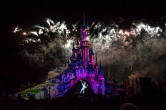 Fairytale Castle in France. Disney Castle painted with lights, fireworks and smoke Royalty Free Stock Image