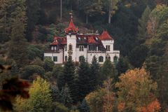 Fairytale castle in the middle of a mountaine of the forest royalty free stock photography