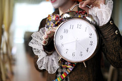 Fairytale character holding an alarm clock Stock Image