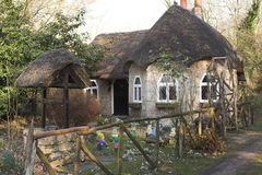 Fairytale cottage. Fairytale thatched cottage in spring Stock Images