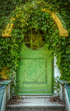 Fairytale Cottage Door. Green Door Of Fairytale Cottage With Round Window royalty free stock image