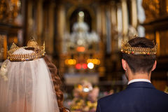 Fairytale couple, bride and groom in crowns during wedding ceremony Royalty Free Stock Photos