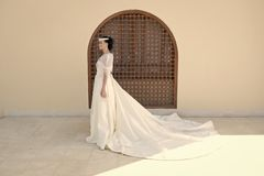 Fairytale dress. Things consider for wedding abroad. Bride adorable white wedding dress sunny day architecture. Background. Wedding ceremony foreign city stock images